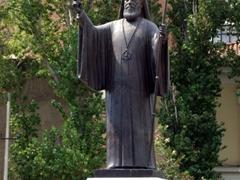 Statue of a priest; near Monastiraki