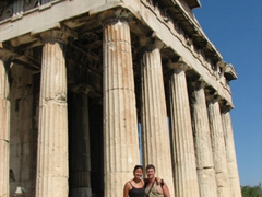 Becky and Robby pose beside the magnificent temple of Hephaesteion
