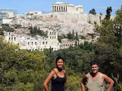 Becky and Robby take a self portrait with the acropolis in the background (photo taken from Filopappos Hill)
