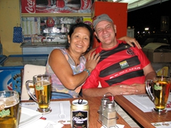 Ann and Bob are all smiles after a hearty meal at Zea Marina; Piraeus