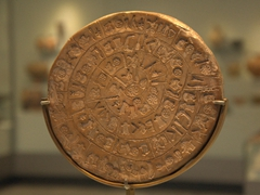 The Phaistos Disc is a clay disc inscribed with hieroglyphics and ideograms