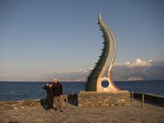 Ann & Bob pose by a glass/bronze sculpture in Agios Nikolaos