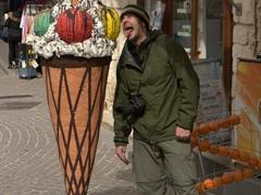 Robby next to a massive ice cream cone; Rethymno