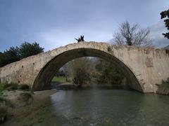 Ann & Bob pose atop the 1850 Turkish Bridge built by the monks of Preveli