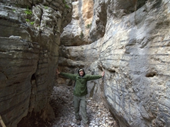 Robby demonstrates the narrowest point of Imbros Gorge (a mere 2 meters wide)
