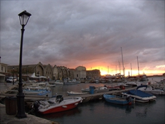 A magnificent sunset over Chania's harbor
