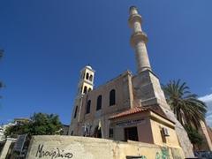 Agios Nikolaos, the patron saint of sailors is half church, half mosque with a church bell tower and a minaret; Chania