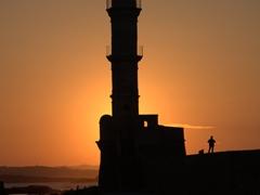 Sunset over Chania's restored Venetian lighthouse
