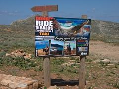 Poster advertising donkey rides to Balos Beach