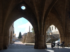 Massive stone archway leading to the Street of Knights