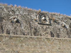 Embedded cannonballs (decorative); outer walls of Old Town Rhodes