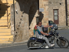 A parrot enjoying a motorcycle ride around old Rhodes