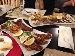"Enjoying our grilled meat and seafood platters at Fotis Melathron (""horseshoe"") restaurant in Old Rhodes"