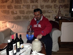 Our gracious host Savvas pouring souma (similar to raki) for us to enjoy; Evdokia Boutique Hotel