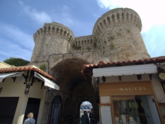 Shops built into the medieval walled city of Rhodes as new blends with old