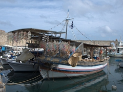 Floating souvenir boats touting seashells for sale; commercial harbor of Rhodes
