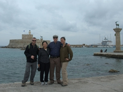 Family photo by Mandraki Harbor. Imagine the Colossus of Rhodes straddling the entrance just behind us! His legs would have stood where the columns of deer are