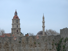 Roloi clock tower and the minaret of the Mosque of Süleyman dominate the skyline of medieval Rhodes