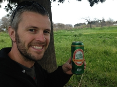 Robby enjoying a beer under a shady tree while we waited for the rain to relent
