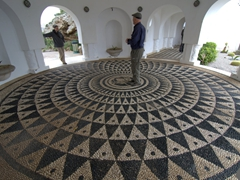 Becky and Bob chat as they take in the marvelous mosaic tiled floor of Kalithea Thermi