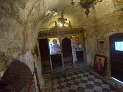 Interior of the 17th century church and its fading frescoes; Panagia Tsambika Monastery