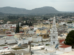The church tower of Archangelos dominates this compact village