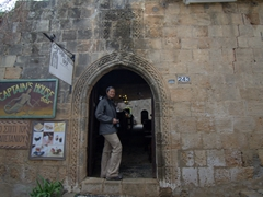Becky in the doorway of Lindos' most picturesque house, the Captain's House Bar