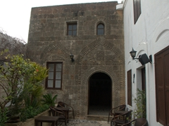 """Interior courtyard of Captain's House Bar leading to a private residence. Check out the detailed carved stonework (known as """"pyliones"""")"""