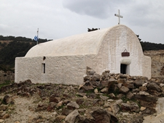 The white church of Ag Panteleimon is all that remains of Monolithos Fortress