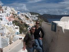 Posing in front of Santorini's white washed buildings