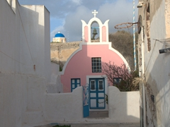 Pink church hidden down a dead end alley; Oia