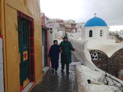Bob & Ann soaked to the bone after a torrential morning downpour in Oia