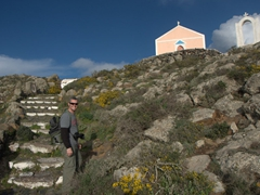There are lots of churches serving as reference points along the hike from Fira to Oia. Here, Robby smiles as he realizes this is the last church before we enter Oia!