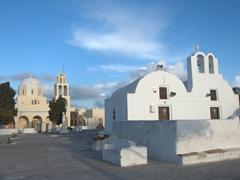 """These two churches mark the beginning of the main pedestrian street of """"Nikolaou Nomikou""""; Oia"""