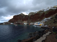 Red cliffs of Ammoudi Bay