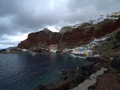 Red cliffs of Ammoudi Bay