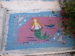 Mermaid welcome mat; Plaka