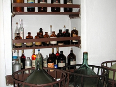 Bottled specimens in the citron manufacturing process; Vallindras Distillery