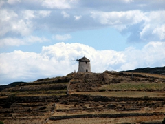 Old windmills stand guard on the outer rim of Lefkes