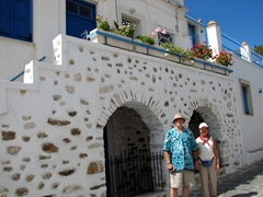 Bob and Ann hold hands while walking through romantic Lefkes