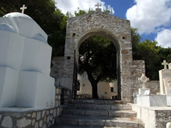 Stone archway leading from Agias Trias Cathedral to a cemetery