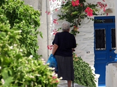 An elderly woman out for a shopping trip in Lefkes