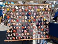 Plenty of seashell ornaments for sale; Naoussa