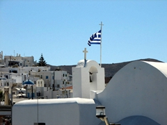 The Greek flag was proudly flapping in the wind; Naoussa Harbor