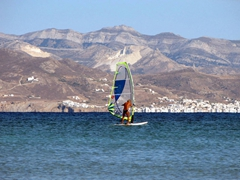 A wind surfer having fun at Santa Maria beach