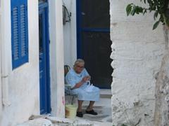 This old lady was knitting away; Parikia