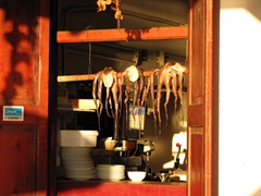 Seeing dried octopus hanging in the window made us crave seafood for dinner tonight