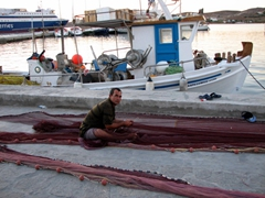 A fisherman tending to his nets; Parikia