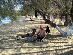 Ann and Bob relaxing at the tamarisk-fringed beach of Livadakia which has fine golden sand, plenty of shady trees, and a cool breeze