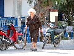 Elderly woman walking to the corner mini market